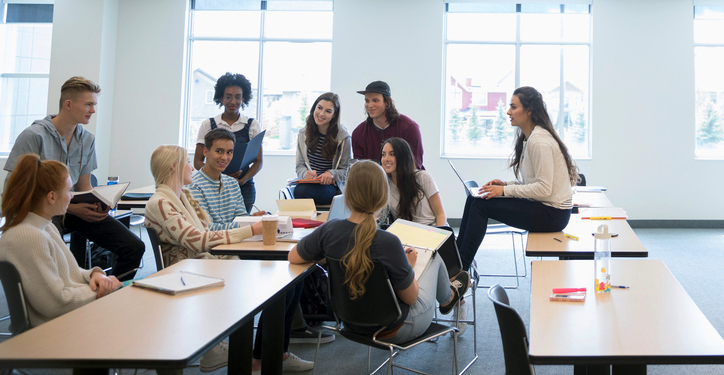 College students talking in group in classroom