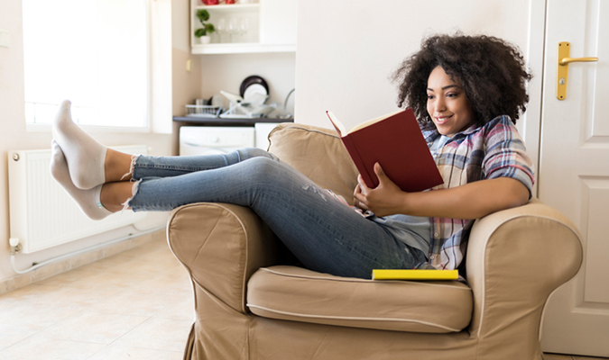 Girl sitting in a chair reading