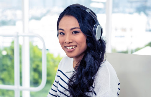 computer-delivered IELTS girl with headphones