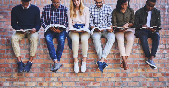 Students on a brick wall
