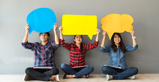 three people with speech bubbles