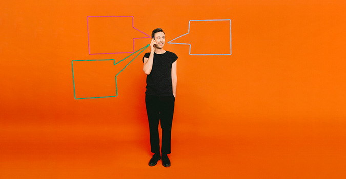 Male on the phone with speech bubbles on an orange background