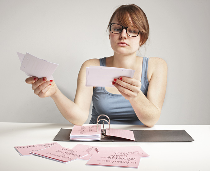 Woman looking at notes