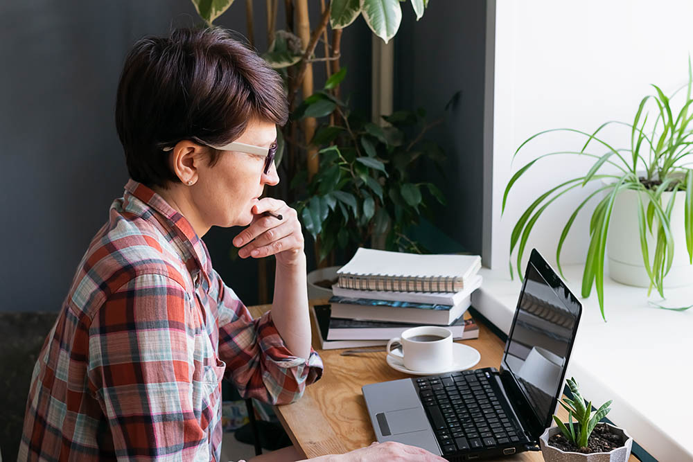 woman at laptop in window